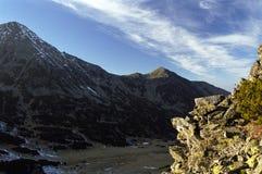 Sunset over Retezat. Sunset is coming over the mountain (Retezat Peak and Lolaia ridge) on November Stock Photos