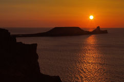 Sunset over Rhossili Bay and Worms head Royalty Free Stock Image