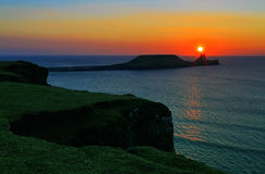 Sunset over Rhossili Bay and Worms head Royalty Free Stock Photos