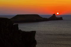 Sunset over Rhossili Bay and Worms head Stock Photo
