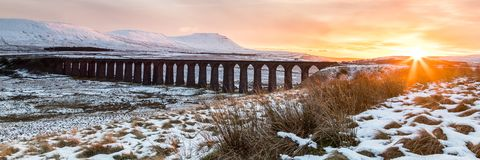 Sunset over the Ribblehead viaduct. In early November snow looking towards Ingleborough. Yorkshire Dales, UK Royalty Free Stock Image