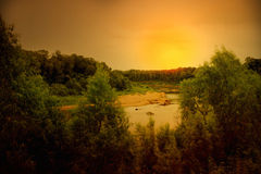 Sunset over a river Royalty Free Stock Photos