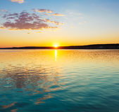 Sunset over the river. Royalty Free Stock Photos