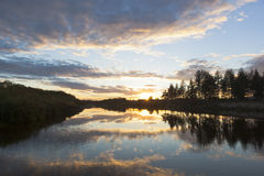 Sunset over a river in autumn Vaga Stock Image