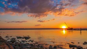 Sunset over the River with Boat in the Background stock footage
