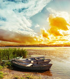 Sunset over river with boats Royalty Free Stock Photos