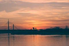 Sunset over the river and bridge, Belgrade, Serbia. Beautiful golden Sunset over the river and bridge, Belgrade, Serbia Royalty Free Stock Images