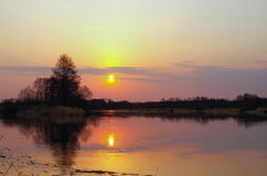Sunset over river Stock Images