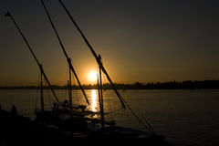 Sunset over river with fellucas. Sunset over the Nile with fellucas in foreground Stock Image