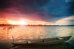 Sunset over the river. Fishing boat near the shore. Royalty Free Stock Image