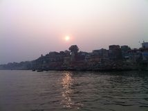 Sunset over River Ganges in Varanasi, India. Through Varanasi, one of the 3 oldest inhabited towns, flows the big river Ganges, which is for the devoted royalty free stock images