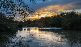Sunset over the River Guadalquivir. As it passes through Córdoba, Andalusia. In November mesde in the Fall. With ducks on water stock photos