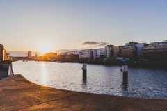 Sunset over the river Liffey and view of DUblin`s skyline. DUBLIN, IRELAND - April 30th, 2018: Sunset over the river Liffey and view of DUblin`s skyline stock photography