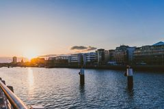 Sunset over the river Liffey and view of DUblin`s skyline. DUBLIN, IRELAND - April 30th, 2018: Sunset over the river Liffey and view of DUblin`s skyline royalty free stock images