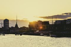 Sunset over the river Liffey and view of DUblin`s skyline. DUBLIN, IRELAND - April 30th, 2018: Sunset over the river Liffey and view of DUblin`s skyline royalty free stock photography