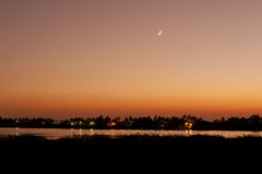 Sunset over a river with the moon Stock Photography