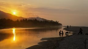 Sunset over the river at Palomino Beach, Colombia.  Stock Photography