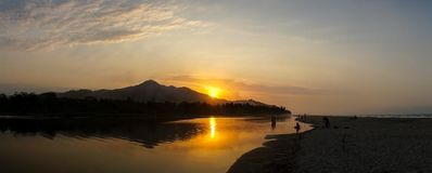 Sunset over the river at Palomino Beach, Colombia.  Royalty Free Stock Photo