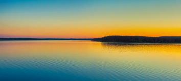 Sunset over the river. Panorama Royalty Free Stock Images