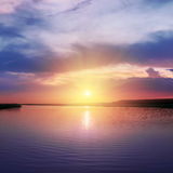Sunset over river in purple colors Royalty Free Stock Photo