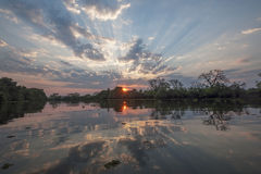 Sunset over river. Sunset reflecting in a river in Pantanal, Brazil Royalty Free Stock Photo