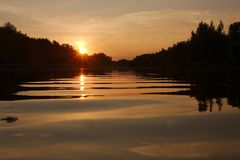 Sunset over a river Royalty Free Stock Image