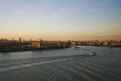 Sunset over river thames. With a tourist cruise boat royalty free stock image