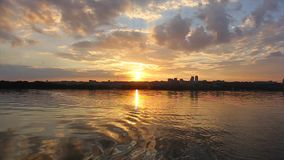 Sunset over the river. View of a sunset in the city stock footage