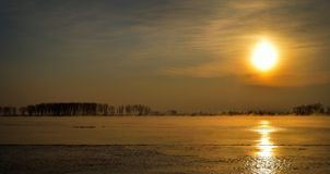 Sunset over the river in winter Stock Photography