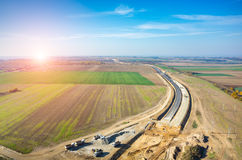 Sunset over road under construction Royalty Free Stock Image