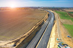 Sunset over road under construction Royalty Free Stock Photography