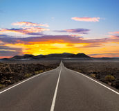 Sunset over road Stock Images