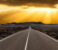 Sunset over road Royalty Free Stock Photos