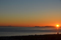 Sunset over Rock of Gibraltar. Sunset of Rock of Gibraltar and Morocco Africa viewed from the hilltop in Sitio de Calahonda Costa del Sol Spain Stock Image