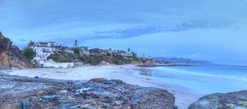 Sunset over the rocks at Shaws Cove. In Laguna Beach as water flows over the stone in HDR Stock Images
