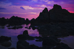Sunset over rocks Stock Photography