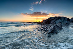 Sunset Over a Rocky Beach Stock Photography