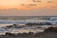 Sunset over rocky coast Stock Photo