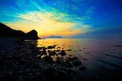 Sunset over a rocky coast Stock Photography