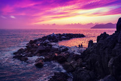 Sunset over rocky coast Royalty Free Stock Photos