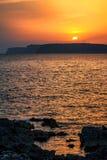 Sunset over the rocky coast. Sunset over the rocky coast of Gozo Island near by Malta, Europe Stock Photo