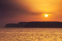 Sunset over the rocky coast. Sunset over the rocky coast of Gozo Island near by Malta, Europe Stock Images