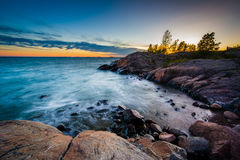 Sunset over rocky coast on Suomenlinna, in Helsinki, Finland. Royalty Free Stock Photography