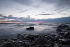 Sunset over a rocky coastline, baltic sea. Sunset over a rocky coastline located in the southern of sweden Stock Photos