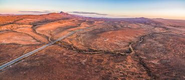 Sunset over rugged alien landscape of Flinders Ranges. Aerial panorama of sunset over rugged alien landscape of Flinders Ranges in South Australia stock photography