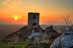 Sunset over ruin of madieval castle Stock Photography