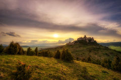 Sunset over the ruins of Spis Castle in Slovakia. Spis Castle is a national monument and one of the biggest European castles by area stock photo