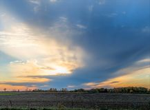 Sunset Over Rural Farm Field Stock Photo