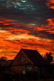 Sunset over Russian village. Royalty Free Stock Image