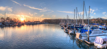Sunset over sailboats in Dana Point harbor Stock Photo